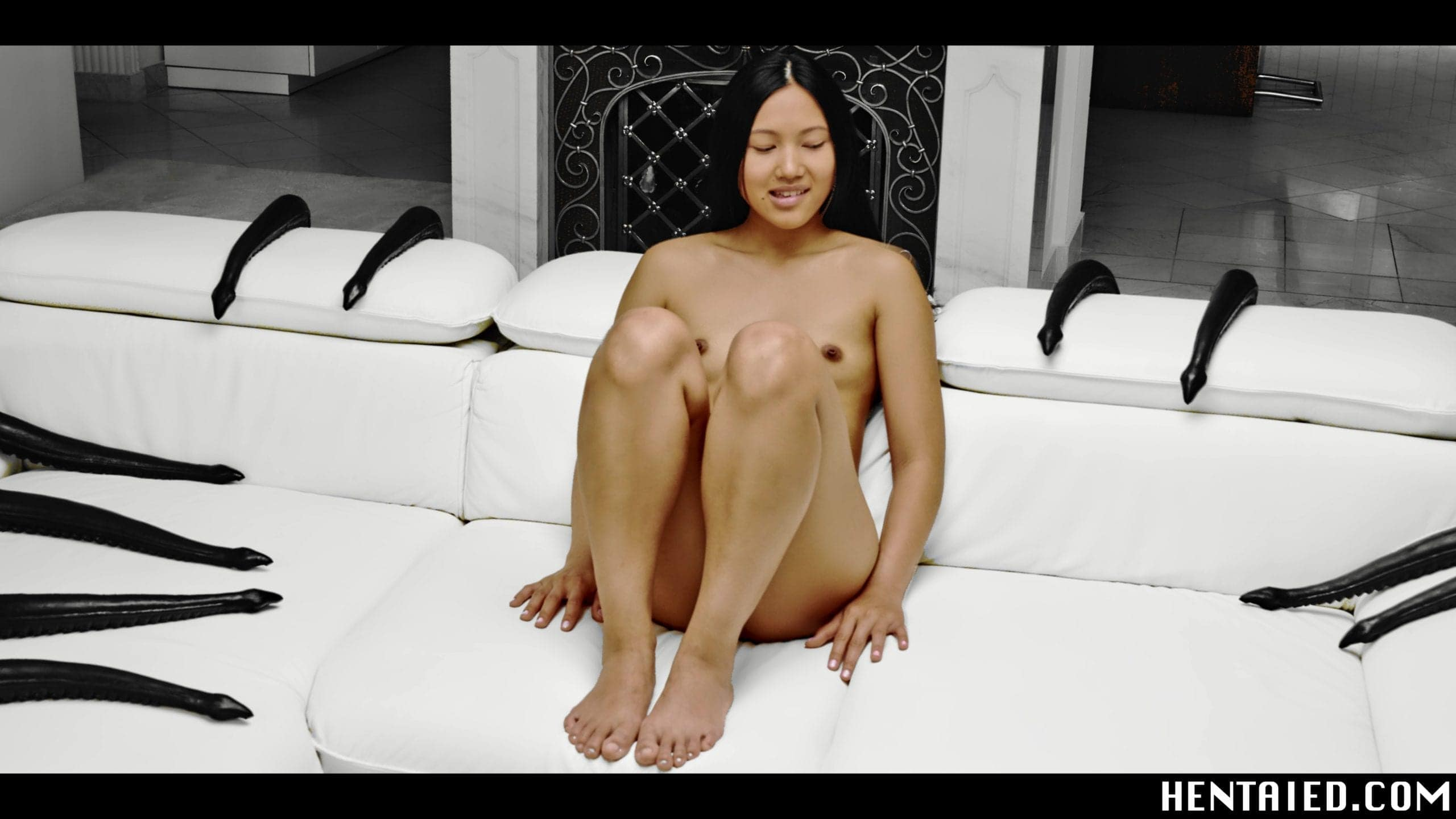 May Thai asian girl sitting on a white couch